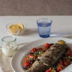 Whole Baked Sea Bass with Olives and Tahini Sauce