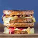 Grilled Comté Cheese Sandwich with Orange and Honey Walnuts and Cranberry Sauce