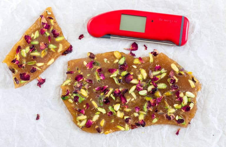 Pistachio cardamom butter brittle with rose petals - Recipes From A Pantry