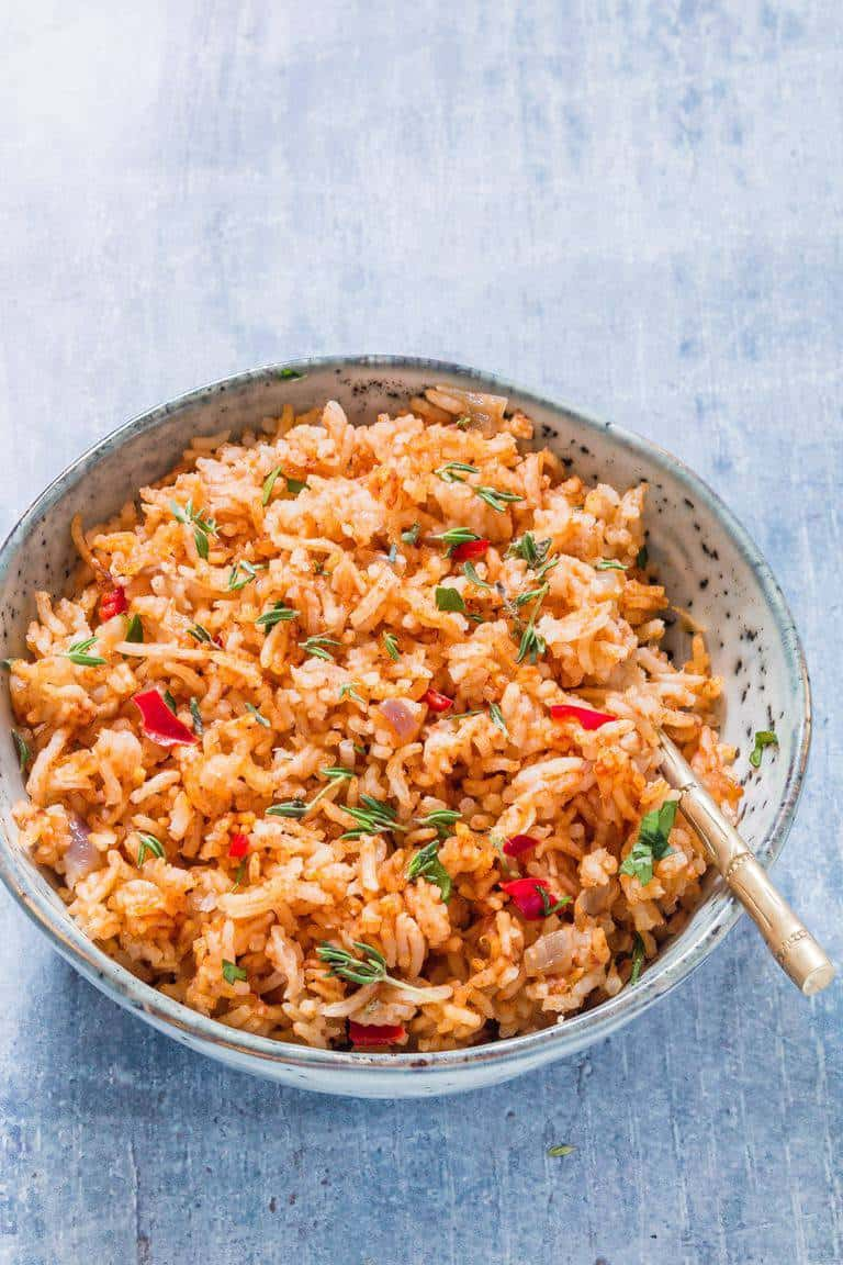 African recipe- Jollof rice (Benachin) is made with rice, tomatoes, stock, onions and any number of variable meats, spices. Vegan and gluten-free. Recipesfromapantry.com