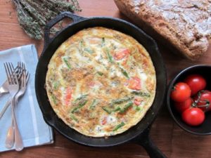 asparagus frittata with feta and thyme in a baking dish