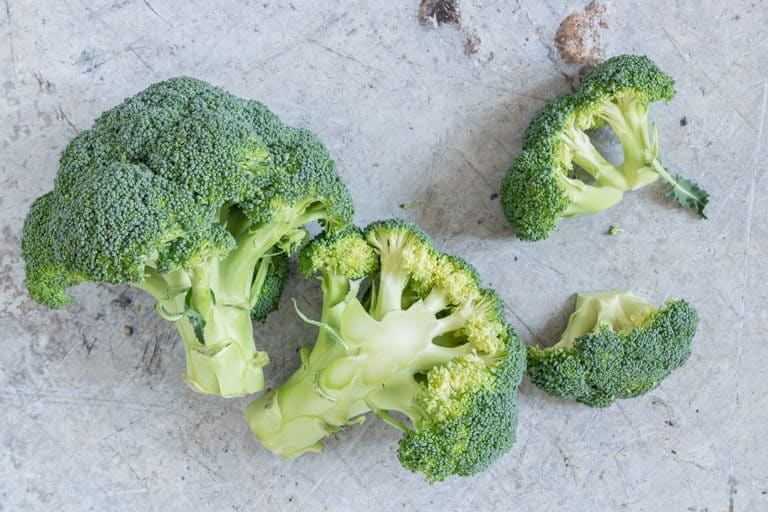 over head shot of 2 heads of uncooked broccoli