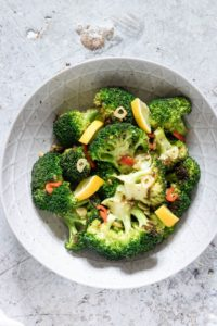 grilled Broccoli in a bowl seasoned with garlic and chilli and lemon