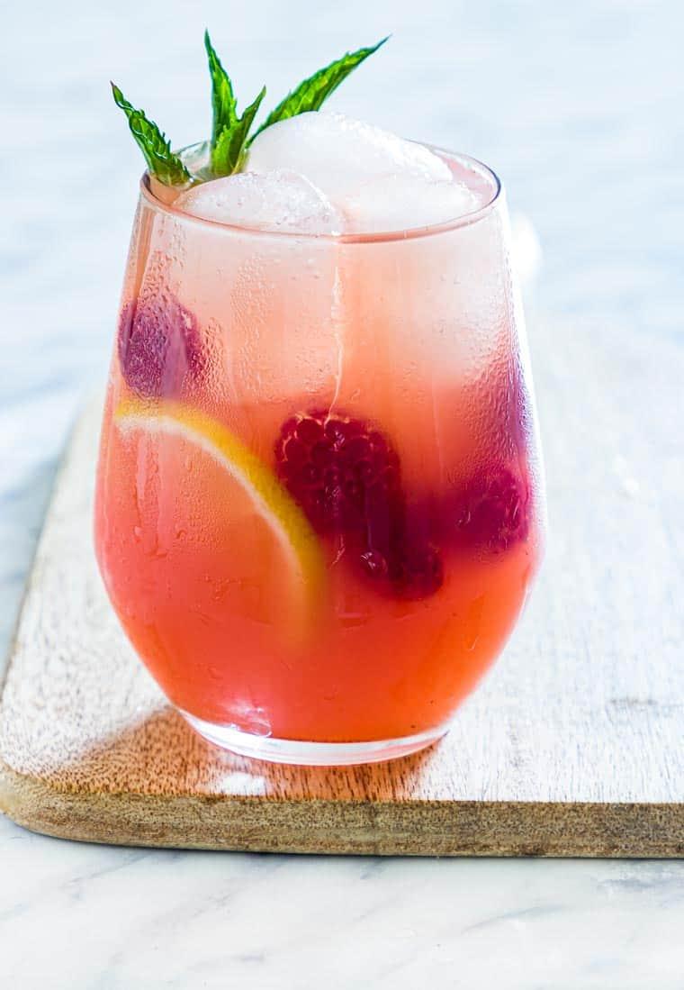 close up of raspberry vodka lemonade on a table