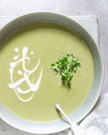 a bowl of ginger spinach soup with cress