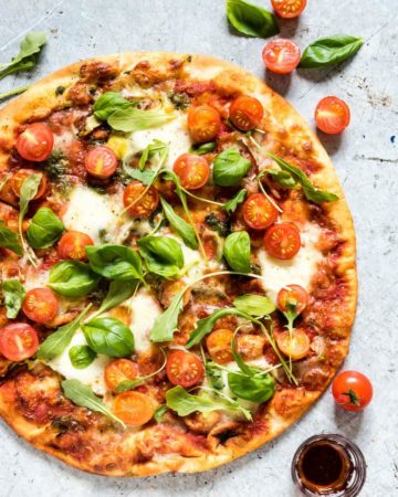 overhead shot of italian pizza dough cooked pizza