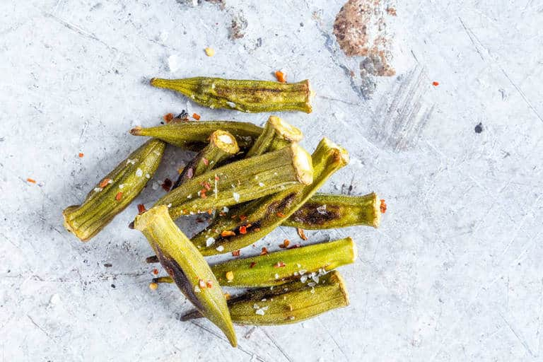 pile of roasted okra with seasoning on top on counter