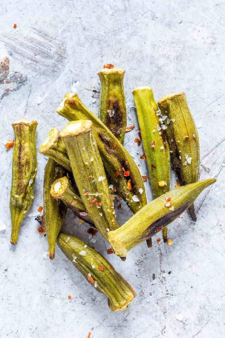 pile of roasted okra pieces with sea salt on top