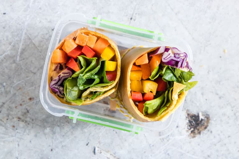 lunchbox eith rainbow vegetable tortilla wrap cut in half