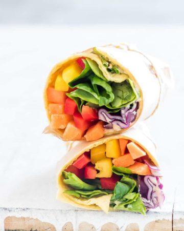a rainbow vegetable tortilla wrap sliced in half
