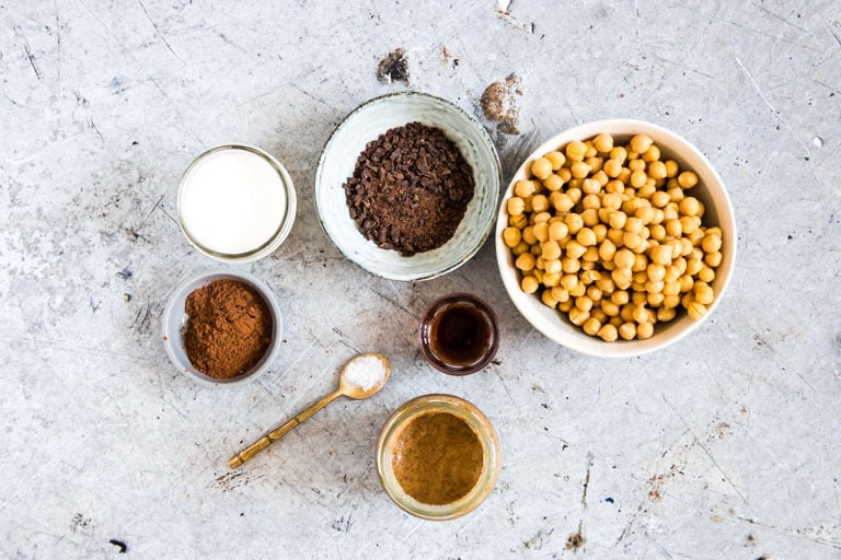 overhead view of ingredients for chocolate hummus including chickpeas and cocoa powder