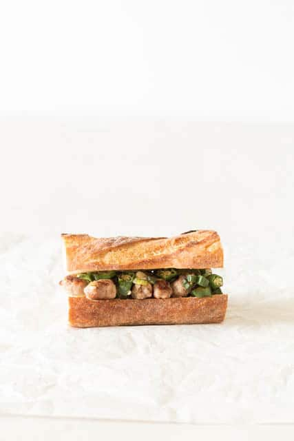 side view of cut okra sandwich on a white background