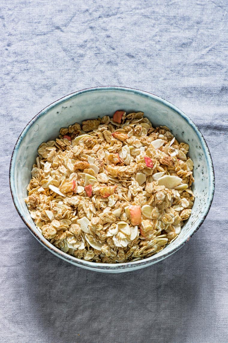 a bowl of apple granola on a table