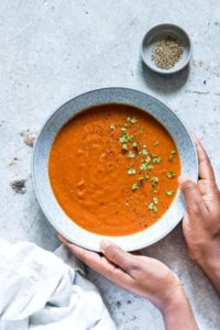 a bowl of slow cooker tomato soup