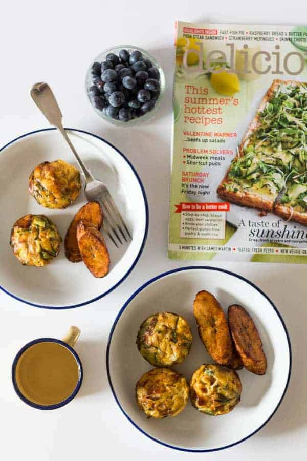 overhead view of a plantain frittata in a bowl next to a spoon and a magazine