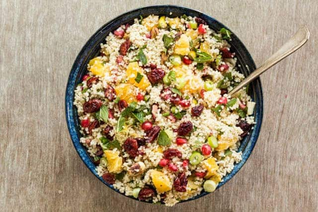 Quick and easy orange pistachio pomegranate couscous salad recipe ready in less than 15 mins. Landscape image. A colourful vegan and vegetarian side dish – recipesfromapantry.com #couscous #couscoussalad #easycouscous #christmasrecipe #howtomakecouscoussalad #vegetariancouscous #moroccancouscous
