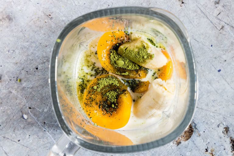 Matcha Smoothie (green Tea Smoothie) in a blender - peaches, milk, matcha, banana