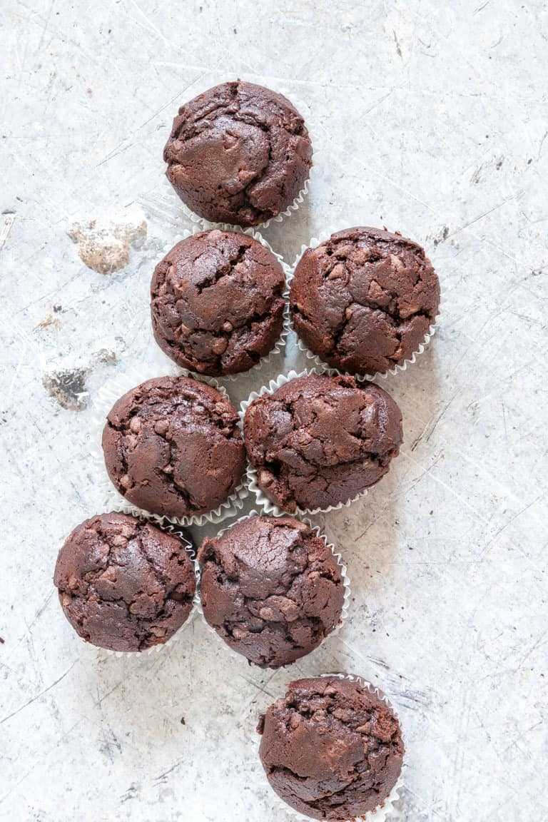 set of chocolate chip muffins on a table