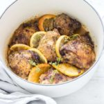 close up of lemon and garlic crockpot chicken thighs garnished with citrus spices