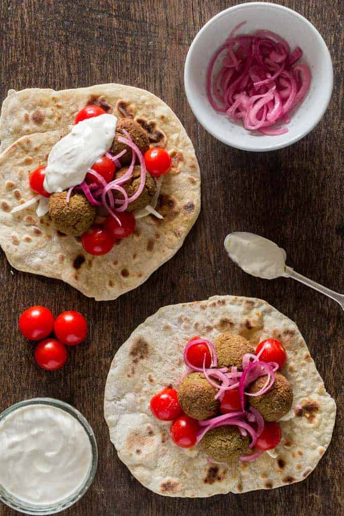falafel served on flatbread with pickled onions and tomatoes