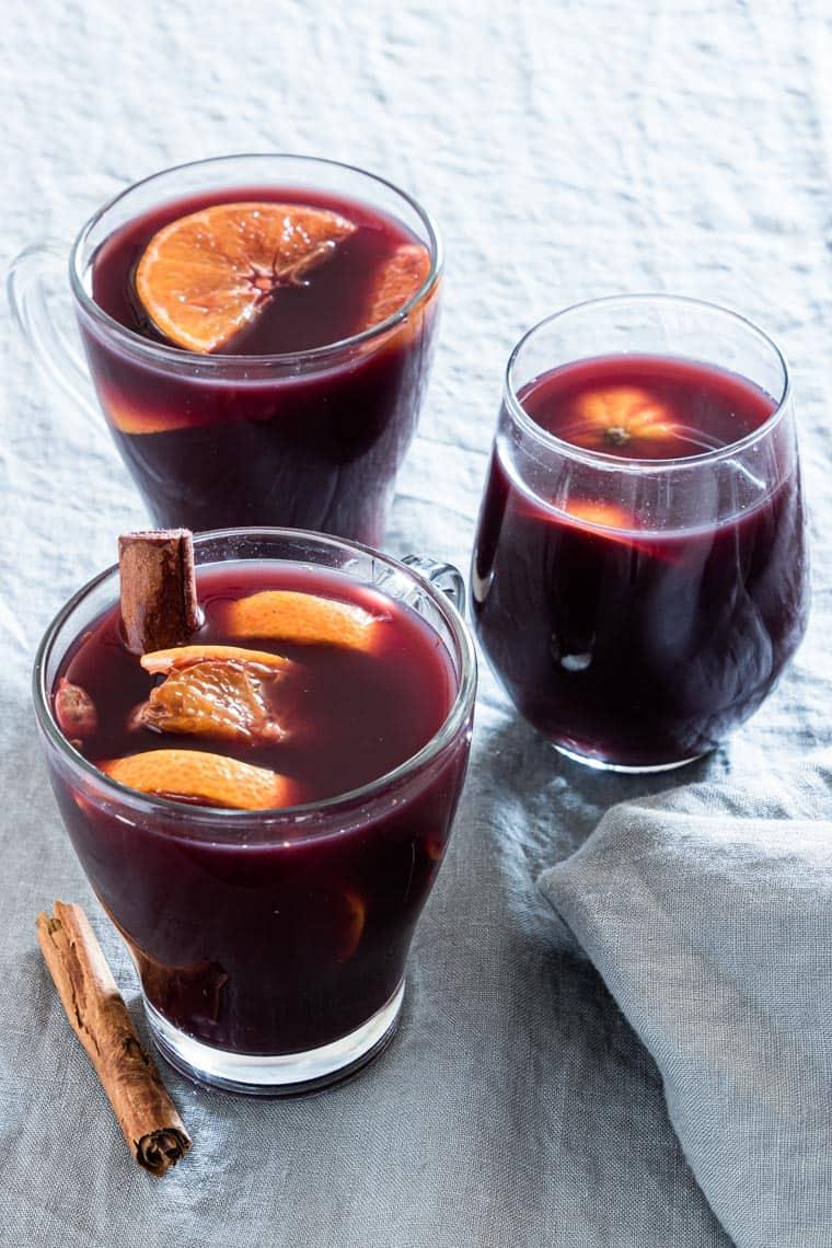 three glasses of orange mulled wine