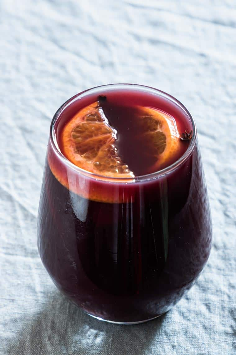 close up of one glass filled with instant pot mulled wine