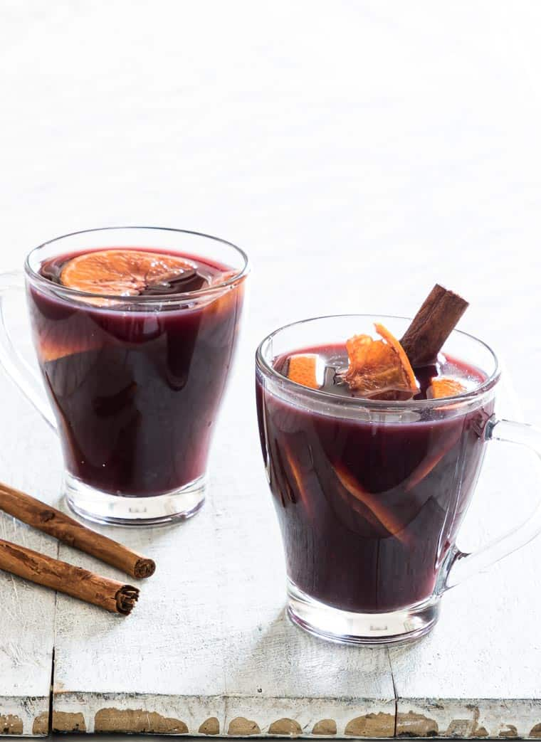 two glass mugs filled with instant pot mulled wine