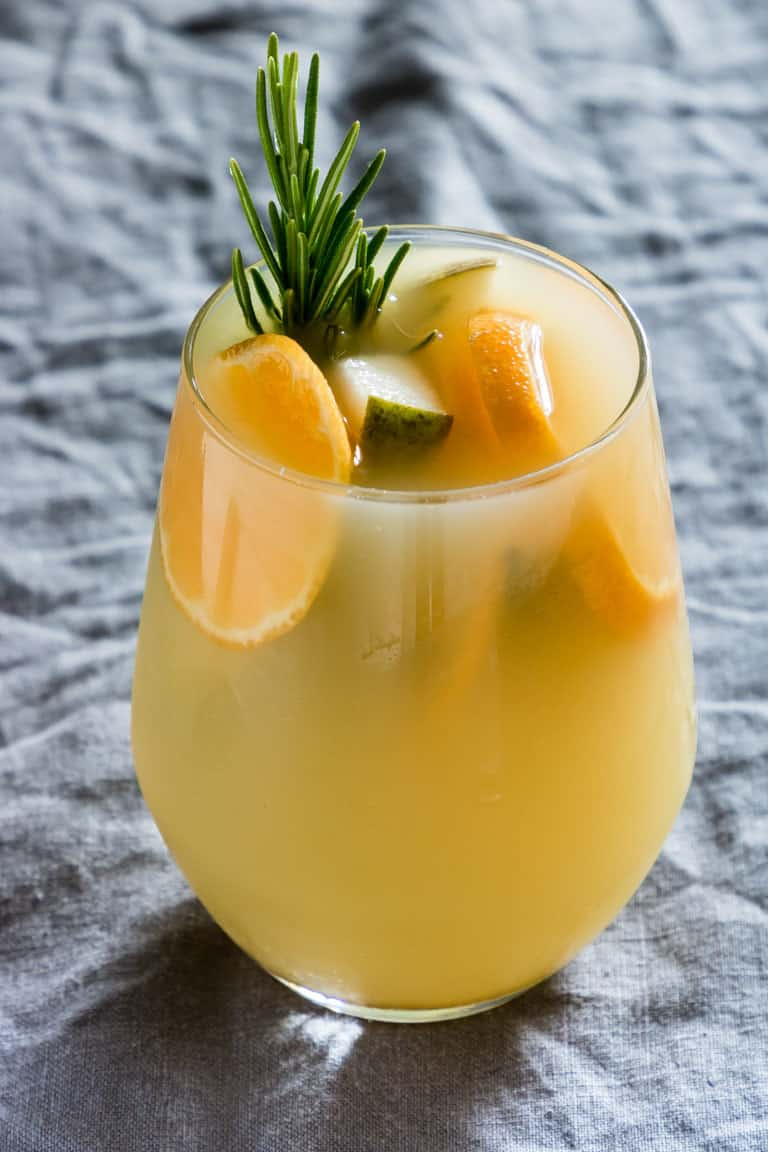 Mulled pear juice with fruits and rosemary