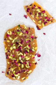 Pistachio cardamom butter brittle with rose petals | Recipes From A Pantry