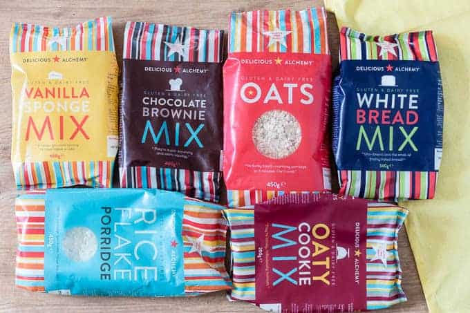 an assortment of six different delicious alchemy gluten free products in bags