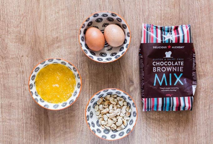 delicious alchemy chocolate brownie mix next to eggs and cashews