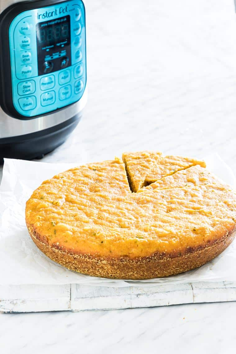 instant pot pumpkin cornbread on a table with the the instant pot