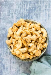 a bowl of roasted coconut cashews
