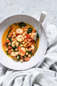 Thai Red King Prawn Curry in a bowl with a sppon