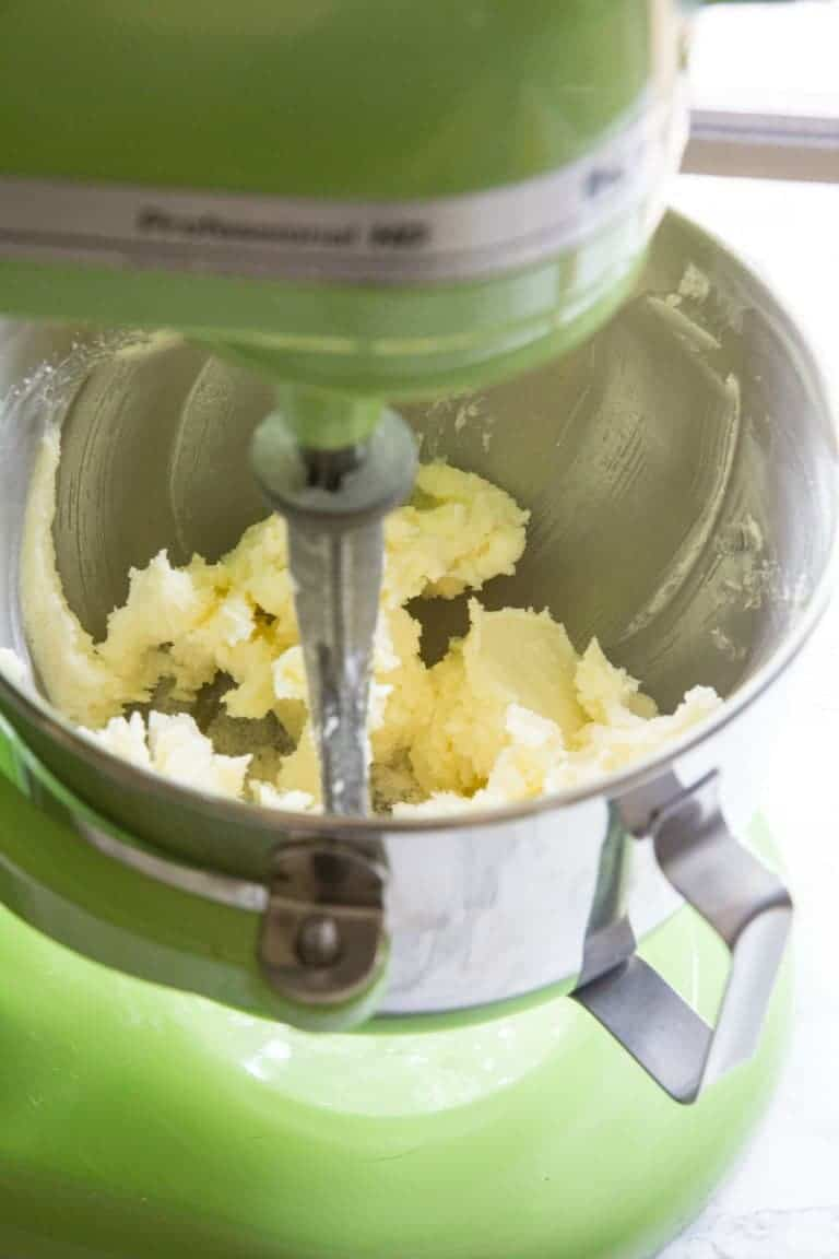 mango cake butter and sugar in a green stand mixer
