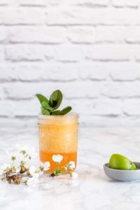 passion fruit daiquiri on a white countertop in front of white brick