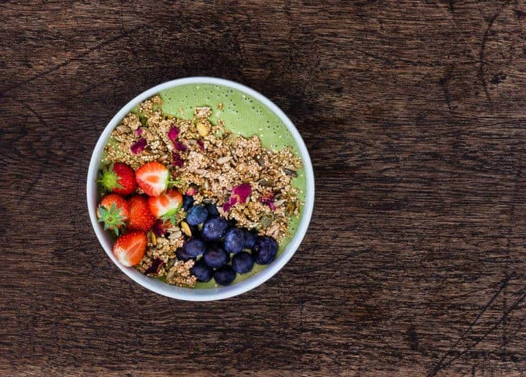 Green Smoothie Bowl (Matcha Green Smoothie Bowl) topped with berries, granola and rose petals