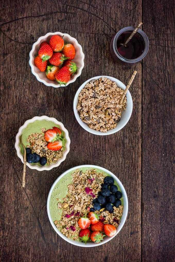 Green Smoothie Bowl (Green Tea Smoothie Bowl) topped with berries, granola and rose petals