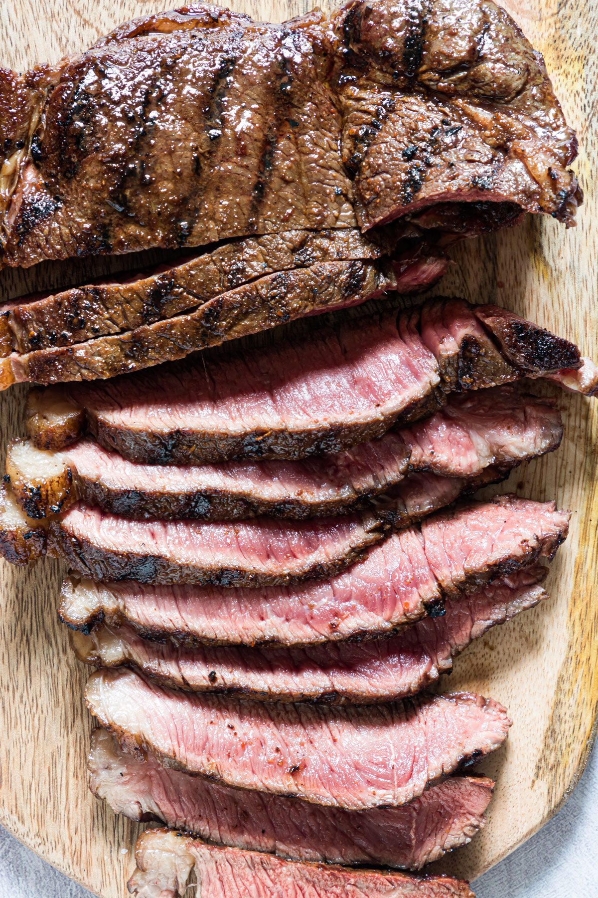 Close up of grilled steak with some slices
