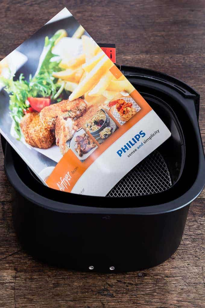 inside of philips air fryer to be used for making a pork satay recipe with peanut sauce