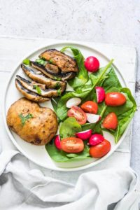 air fryer mushroom steaks served with a green salad