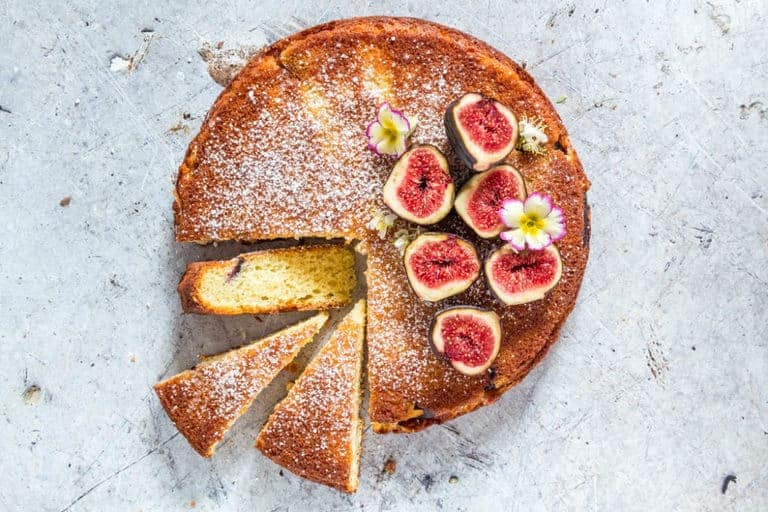 Fig And Semolina Cake on a grey background with three slices of cake