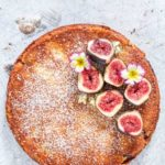 Fig And Semolina Cake topped with figs and flowers