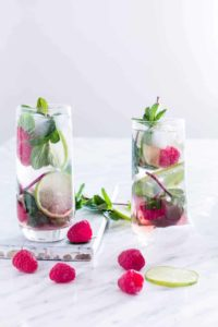 two glasses of Raspberry Mojito - Refreshing & simple raspberry mojito recipe made with 5 ingredients - fresh raspberries