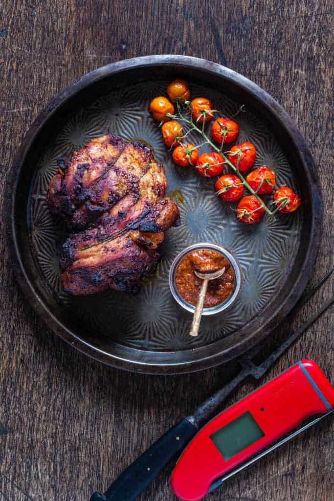 This roast lamb stuffed with harissa apricots with roasted tomatoes, harissa and a thermometre
