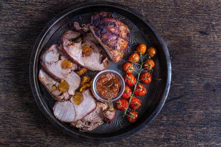 Sliced roast lamb stuffed with harissa apricots