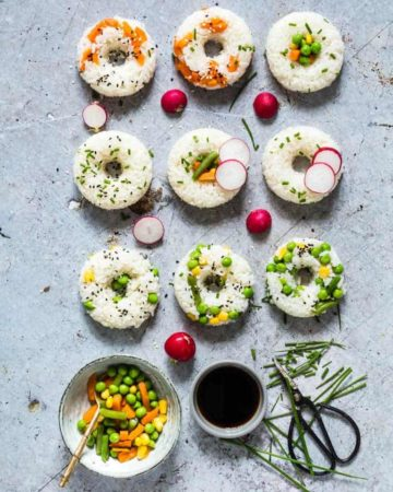 Vegetable Sushi Doughnuts on a table with condiments