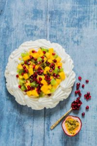 This kiwi mango pavlova with coconut whipped cream is an easy dessert recipe that takes 10 mins to make and guaranteed crowd pleaser. recipesfromapantry.com.