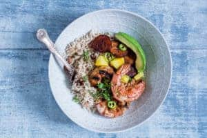 These jerk shrimps with coconut rice and peas recipe work well for every meal you can imagine. African recipe.