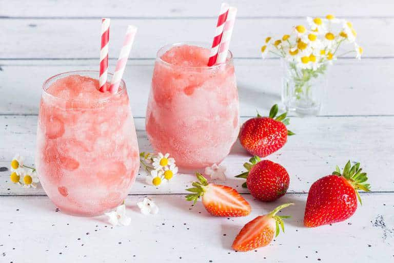 This ice cold strawberry frosé (frozen rosé) recipe is the perfect cooling drink for hot, hot summer days. Try it now. recipesfromapantry.com